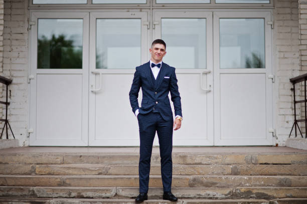 Portrait of a handsome high school graduate in stylish tuxedo posing picture id861157664?b=1&k=6&m=861157664&s=612x612&w=0&h=przbupulfl0c06siidkmazb6blv5ieijgdaenrd1ham=