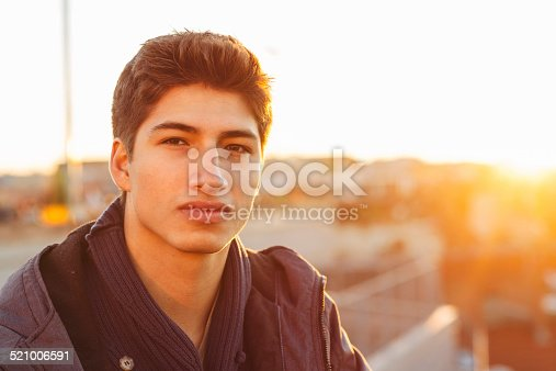 521022435istockphoto Portrait of a handsome man in the back light 521006591