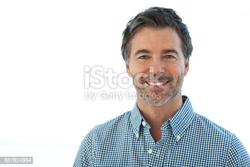 637538262istockphoto Portrait Of A Handsome man Isolated On white. Smiling 637624994
