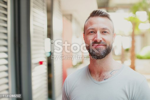 Portrait, Handsome, Positive, Cool Attitude - Handsome man smiling at the camera for a portrait