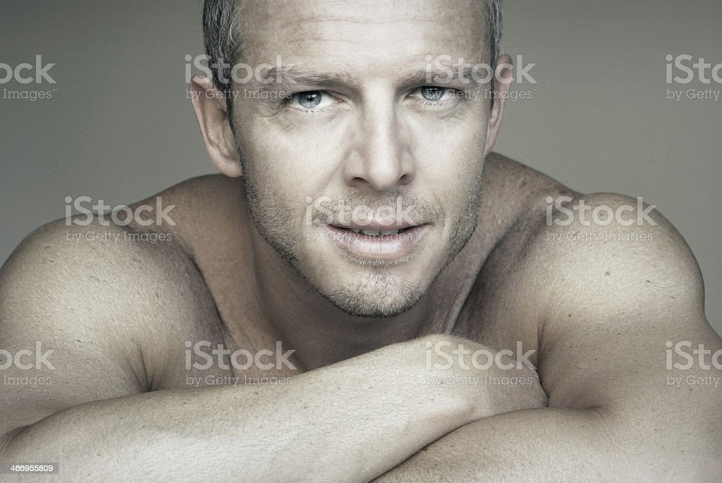Portrait of a handsome man shirtless with arms folded stock photo