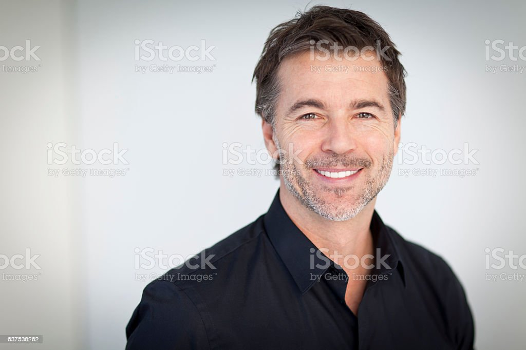 Portrait Of A Handsome Man Smiling Isolated On White stock photo