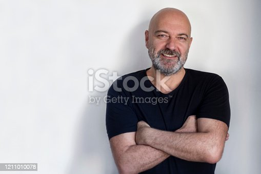 Portrait of a handsome man at the white background. Smiling man looking at the camera.