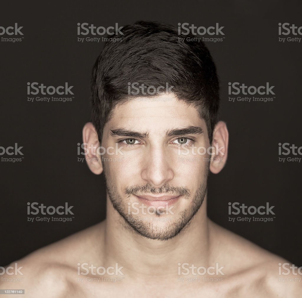 Portrait of a handsome man smirking royalty-free stock photo