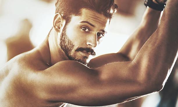 portrait of a handsome muscular man. - 肩 ストックフォトと画像