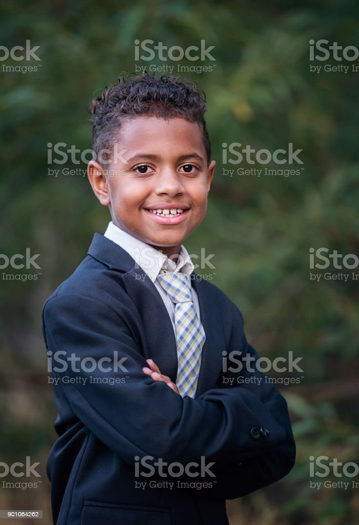 Portrait of a handsome young African American boy in formal clothing stock photo