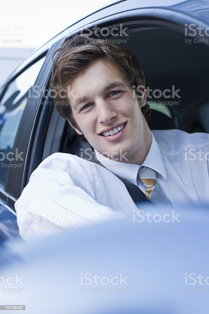 Portrait of a handsome young businessman driving car royalty-free stock photo