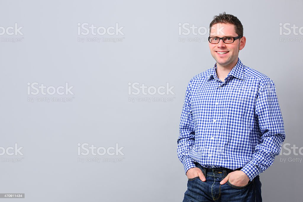 Portrait of a handsome young man smiling stock photo
