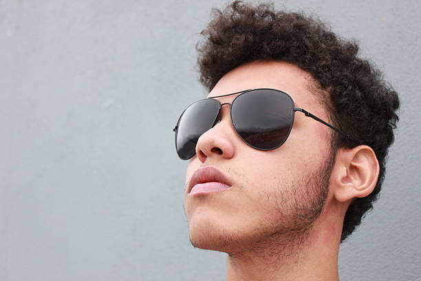 Portrait of a handsome young man whit sunglasses stock photo