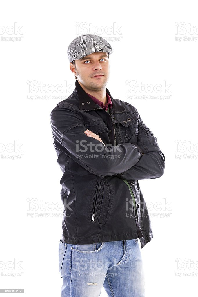 Portrait of a  handsome young man with arms folded royalty-free stock photo