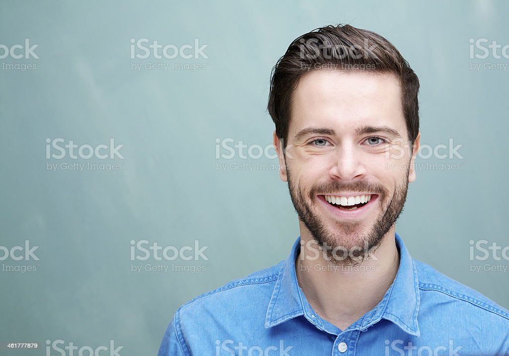 Portrait of a handsome young man with beard smiling stock photo