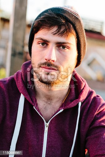 521022435istockphoto portrait of a handsome young men in front of urban background 1150699951