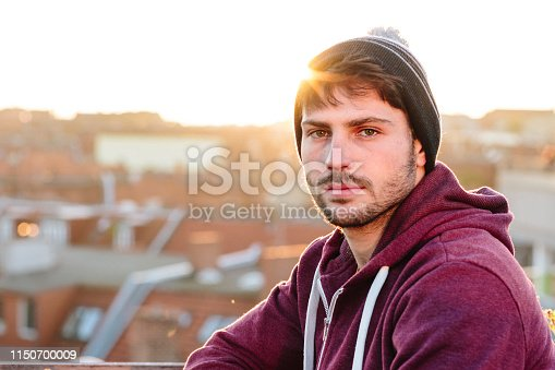521022435istockphoto portrait of a handsome young men in front of urban background 1150700009