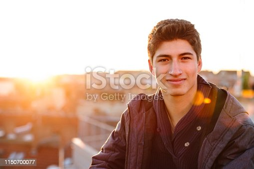 521022435istockphoto portrait of a handsome young men in front of urban background 1150700077