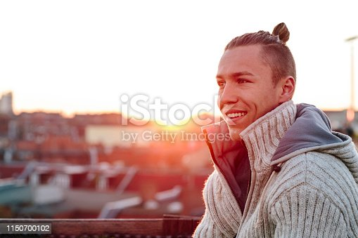 521022435istockphoto portrait of a handsome young men in front of urban background 1150700102
