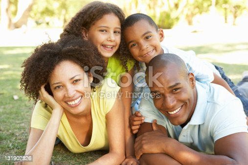 istock A portrait of a happy African-American family in the park 131902826