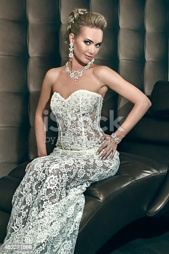 istock Portrait of a happy beautiful bride sitting on chair 482271566