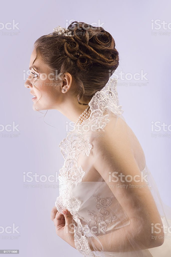 Portrait of a happy beautiful bride with fancy hairstyle. royalty-free stock photo