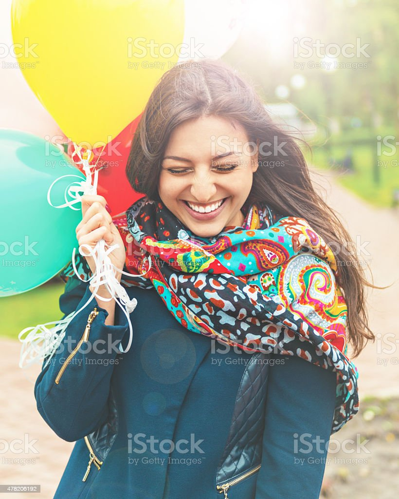 Portrait of a happy beautiful woman with balloons stock photo