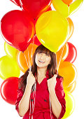 istock Portrait of a happy beautiful young Japanese woman holding balloons 174981582