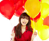 istock Portrait of a happy beautiful young Japanese woman holding balloons 174995298