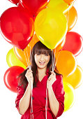 istock Portrait of a happy beautiful young Japanese woman holding balloons 175243646