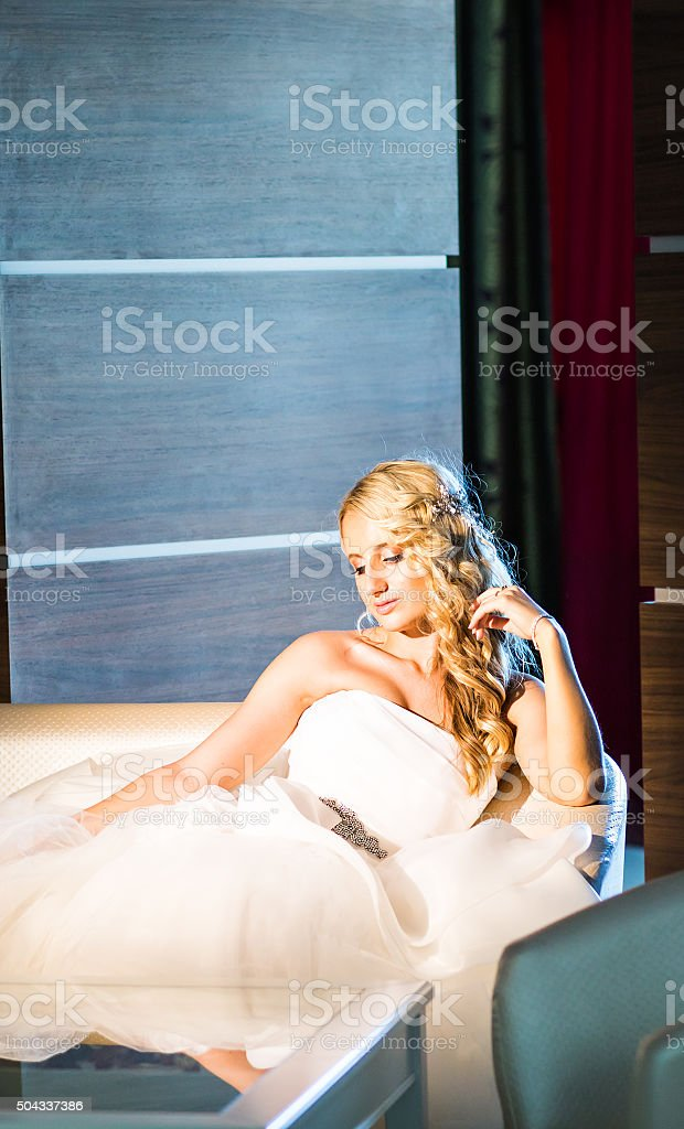 portrait of a happy bride holding flowers stock photo