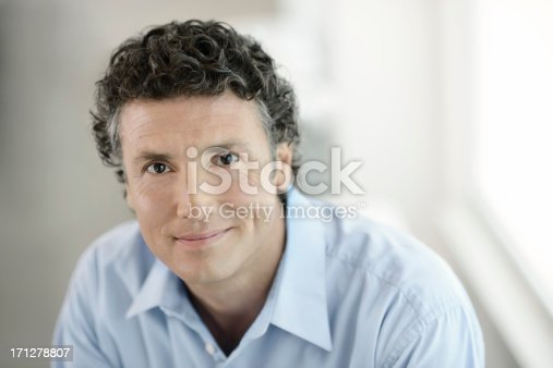 istock Portrait of a happy businessman 171278807