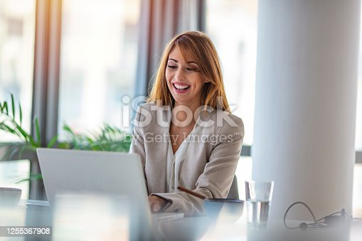 637233964 istock photo Portrait of a happy businesswoman working at her office desk. 1255367908