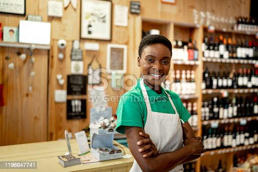 Portrait of a happy cashier working in a restaurant