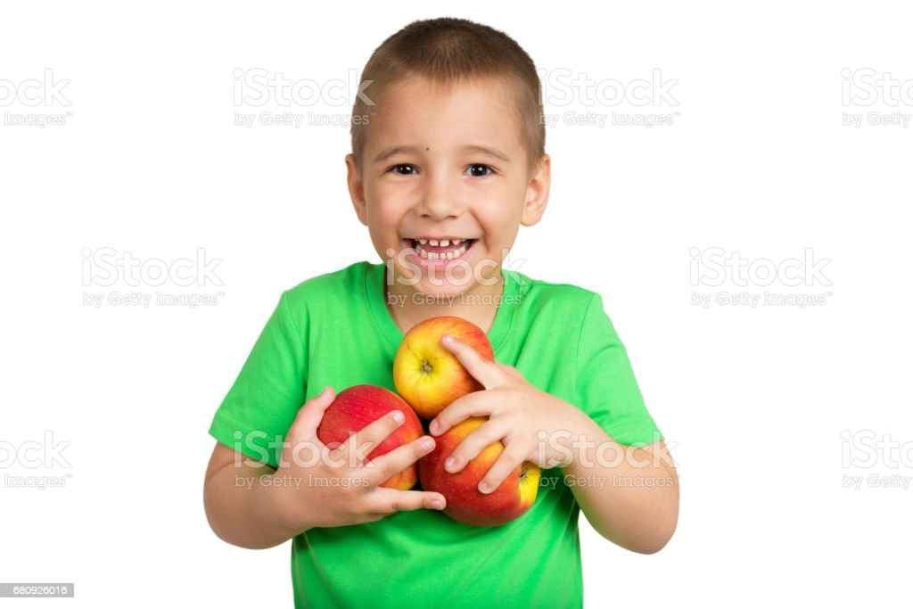 Portrait of a happy child with apples in hands on a white background royalty-free stock photo