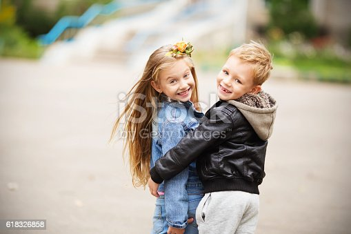 istock Portrait of a happy children - boy and girl 618326858