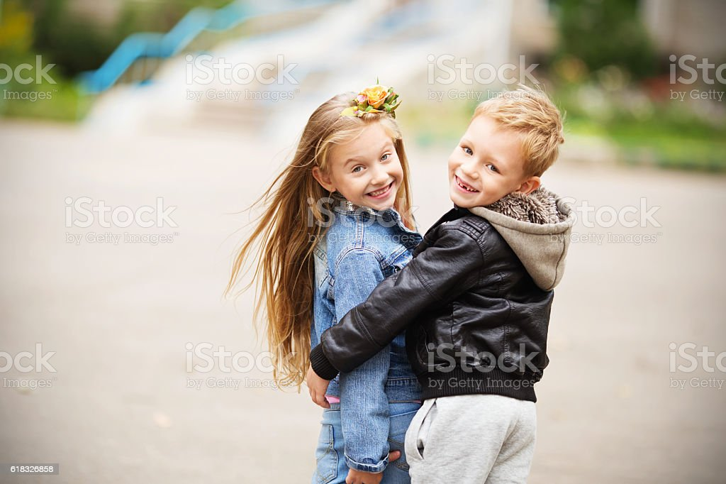 Portrait of a happy children - boy and girl stock photo