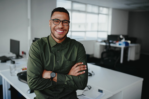 Portrait Of A Happy Confident Young African American Businessman Standing With His Arms Crossed Looking At Camera Stock Photo - Download Image Now