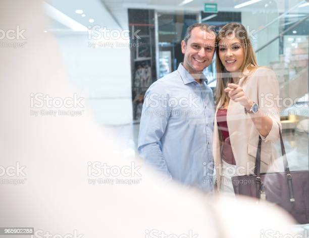 Portrait Of A Happy Couple Shopping At The Mall Stock Photo - Download Image Now