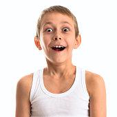 Portrait of a happy cute boy on a light background.
