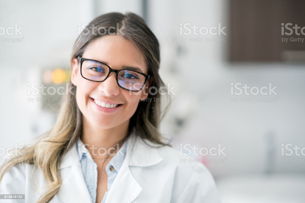 Portrait of a happy doctor at the hospital stock photo