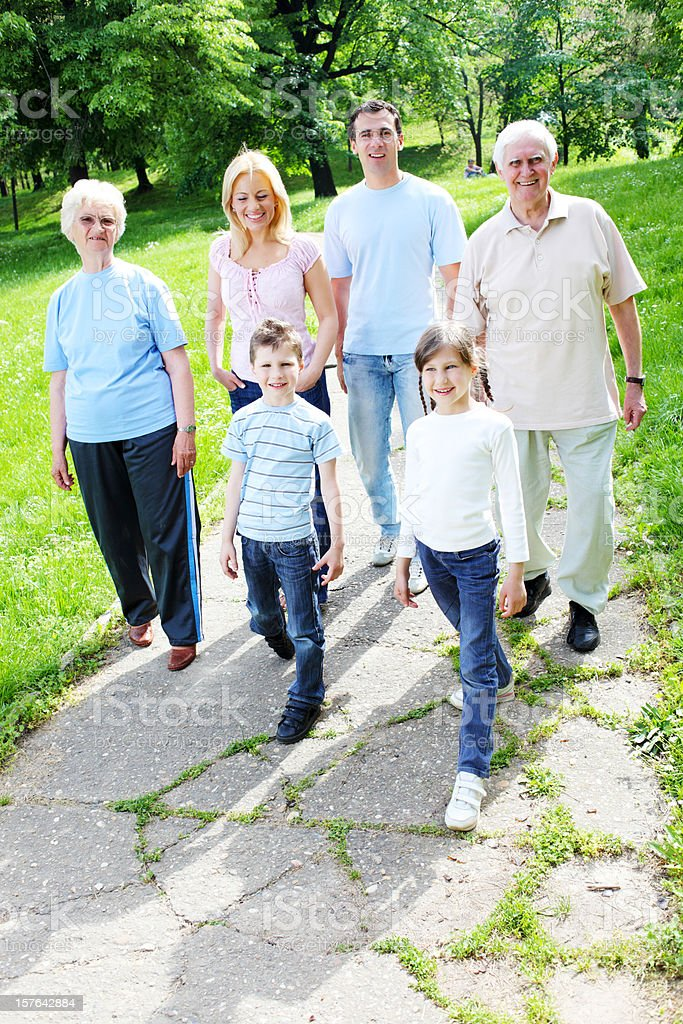 Portrait of a  happy family walking in the park. royalty-free stock photo