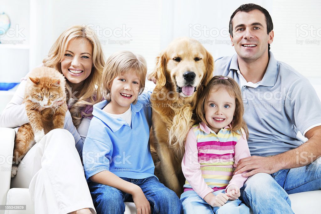 portrait of a happy family with pets stock photo istock. Black Bedroom Furniture Sets. Home Design Ideas