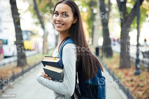 Portrait of a happy female student holding books picture id488580098?b=1&k=6&m=488580098&s=612x612&h=75gmxknsjzhgv2k6zwyuc1u3q2mytwyjjbc5hx 3lk8=