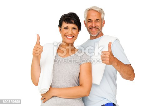 istock Portrait of a happy fit couple gesturing thumbs up 692879656