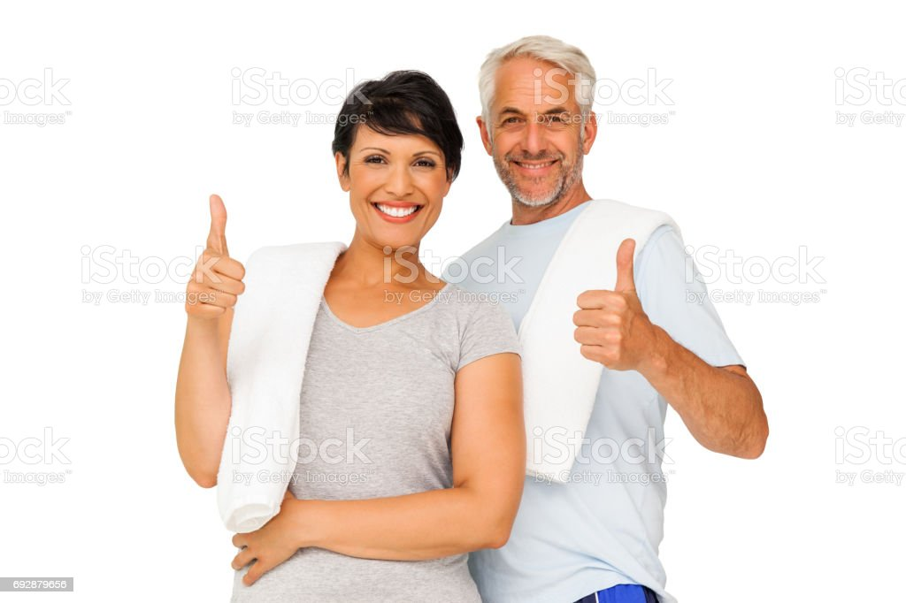 Portrait of a happy fit couple gesturing thumbs up – zdjęcie