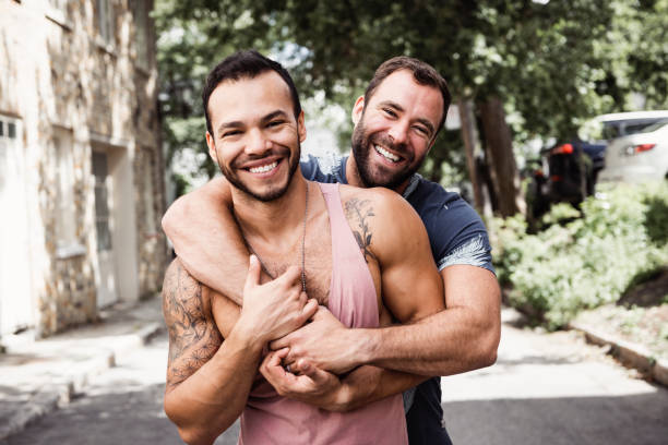 A Portrait of a happy gay couple outdoors in urban background stock photo