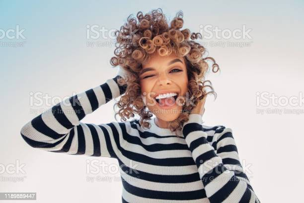 Photo of Portrait of a happy girl against blue sky