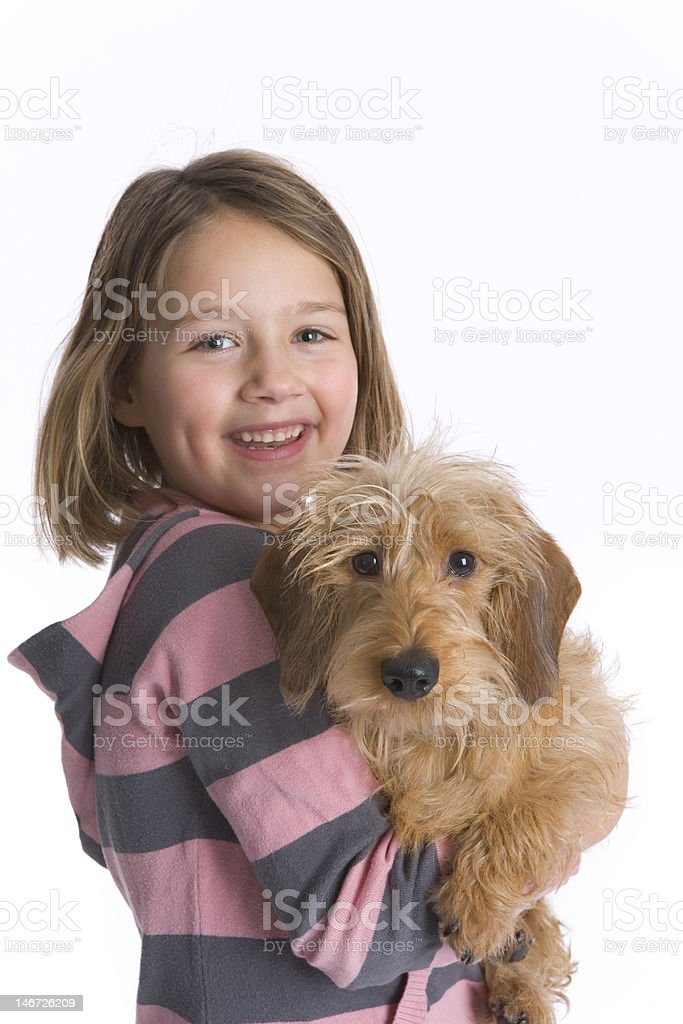 Portrait of a happy girl with her dog stock photo
