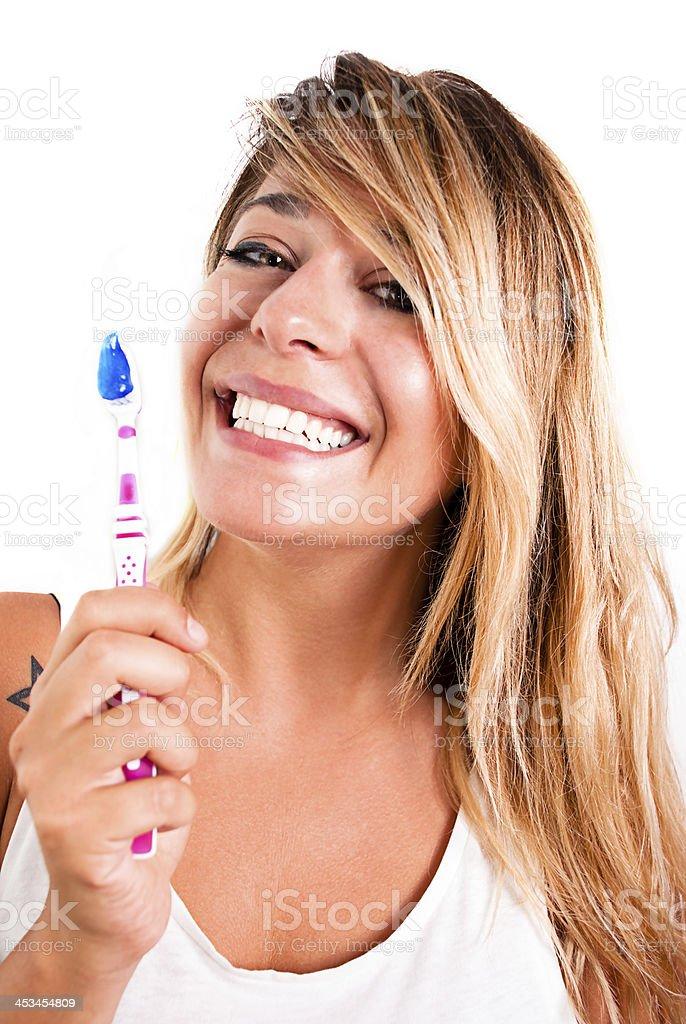 Porträt von eine glückliche Mädchen mit Zahnbürste. – Foto
