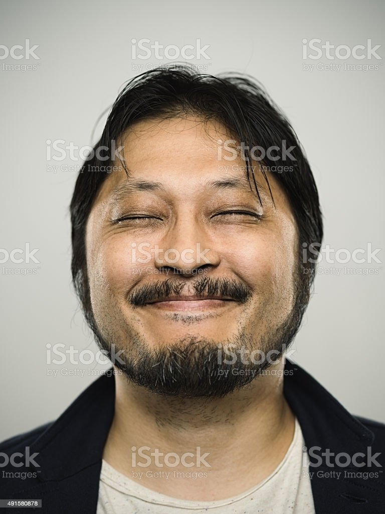 Portrait of a happy japanese man looking at camera stock photo