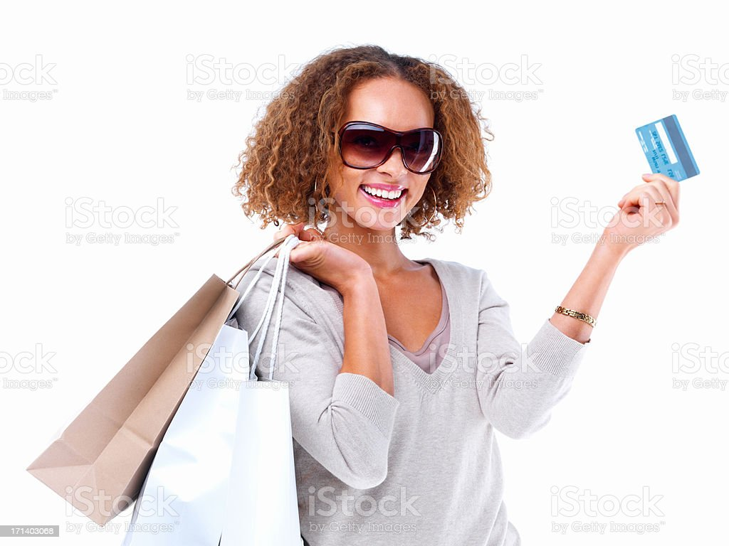 Portrait of a happy lady holding credit card and shopping bags isolated on white background stock photo