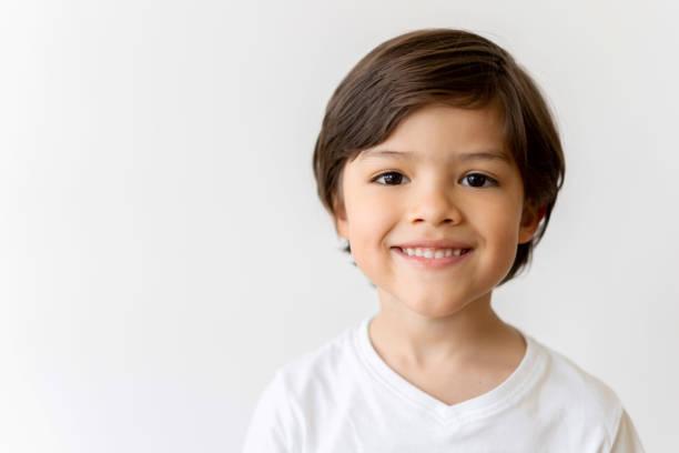 Portrait of a happy Latin American boy smiling stock photo