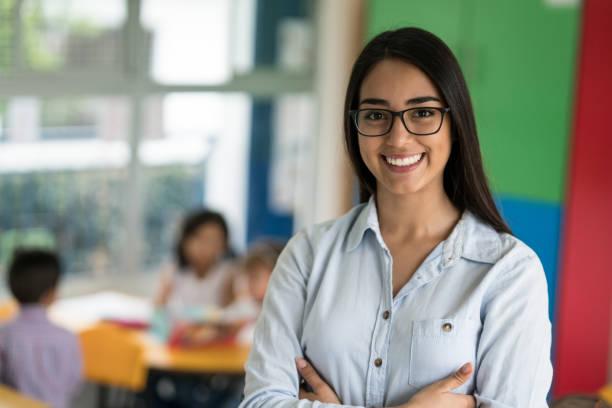 Portrait of a happy latin american teacher at the school picture id687830554?b=1&k=6&m=687830554&s=612x612&w=0&h=ykorqghtxdsdraqsgozmahz0ca5ijabkvp6v86qewgs=
